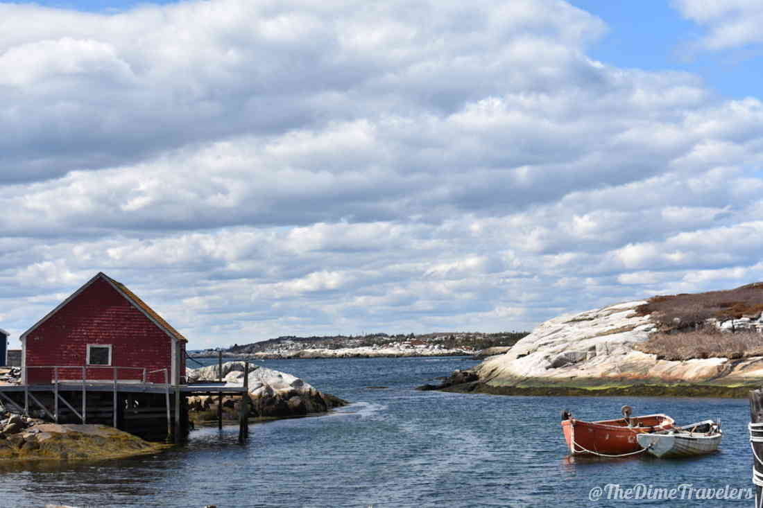 House on the water with canoes in Peggys Cove Nova Scotia