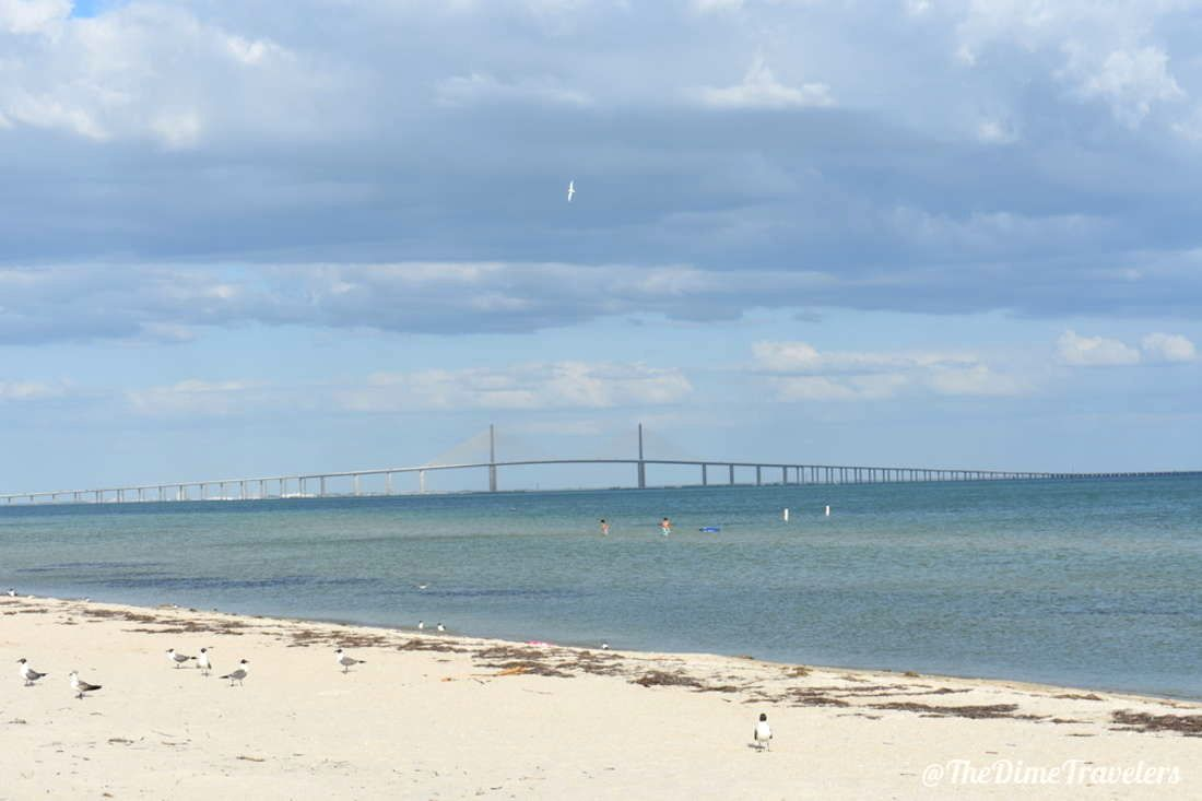 Beach with ocean and bridge in background