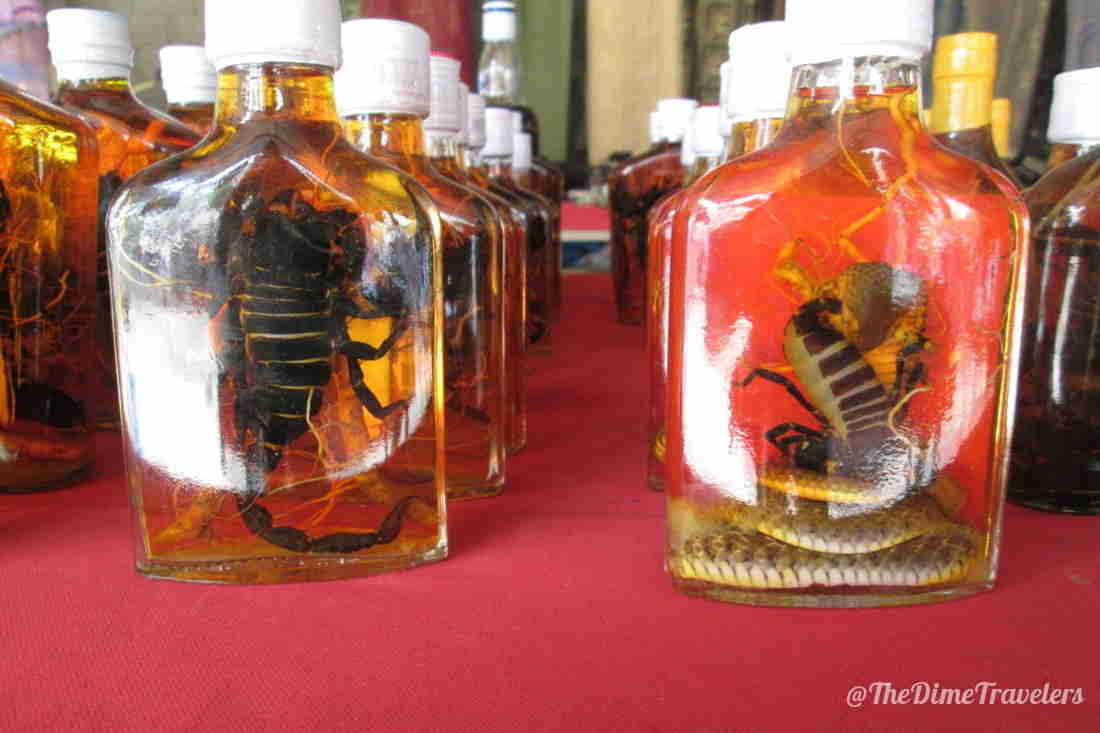 Snakes and scorpions drowned in bottles of alcohol for sale in Lao