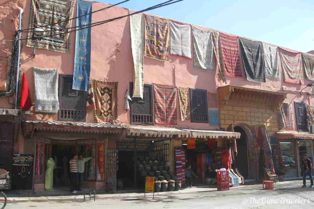 Carpets on building and shops in Morrocco