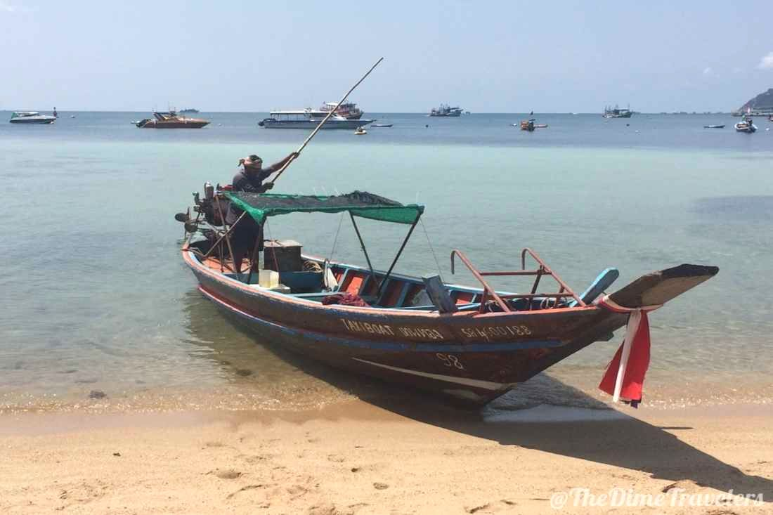 Long Tail boat on the beach in Ko Tao Thailand